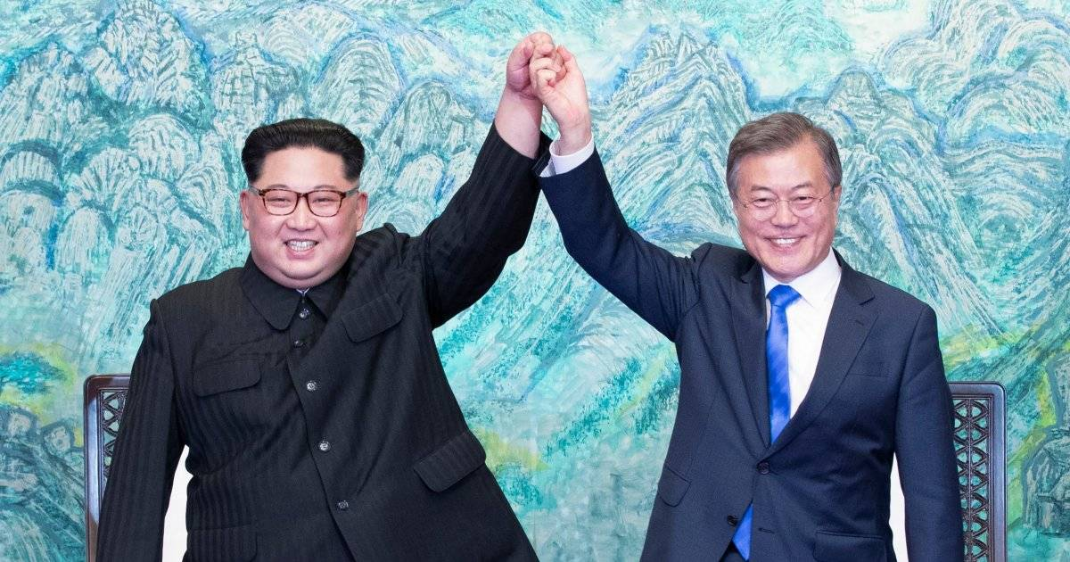 Kim-Jong Un Is All Smiles And Shaking Hands With The South Korean Leader In An Iconic Picture