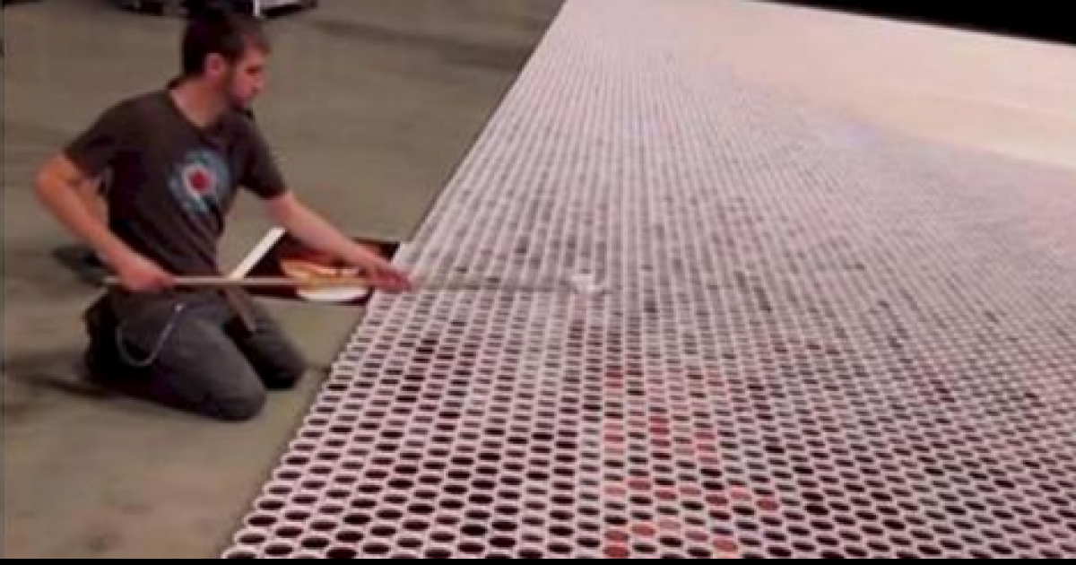 He Positioned 66000 Cups Full Of Water. When The Camera Zooms Out Everyone Is Blown Away.