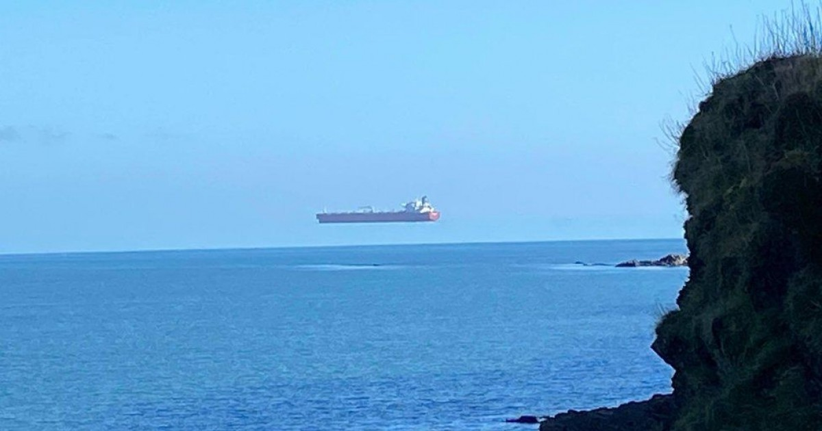 Astonishing Photo Shows A Giant Ship Hovering Over The Sea Off The Coast Of Cornwall