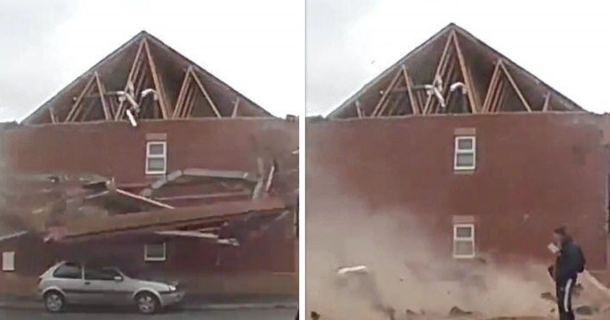 Man Casually Strolls Past House As It Collapses To The Ground