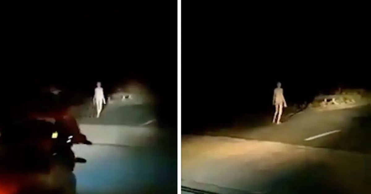 Creepy 'Alien' Figure With Long Limbs And Pale Skin Walks Along Bridge At Dead Of Night