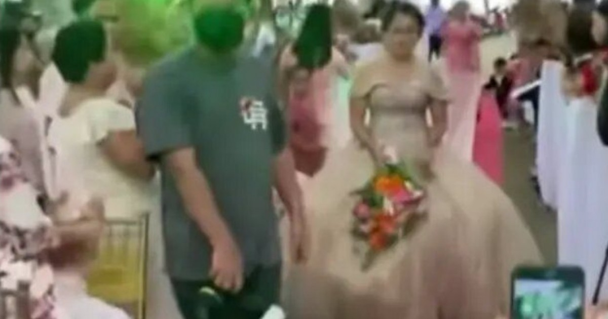 Wedding Planner Hides Under Bride's Gown To Help Her Walk Amid The Strong Winds