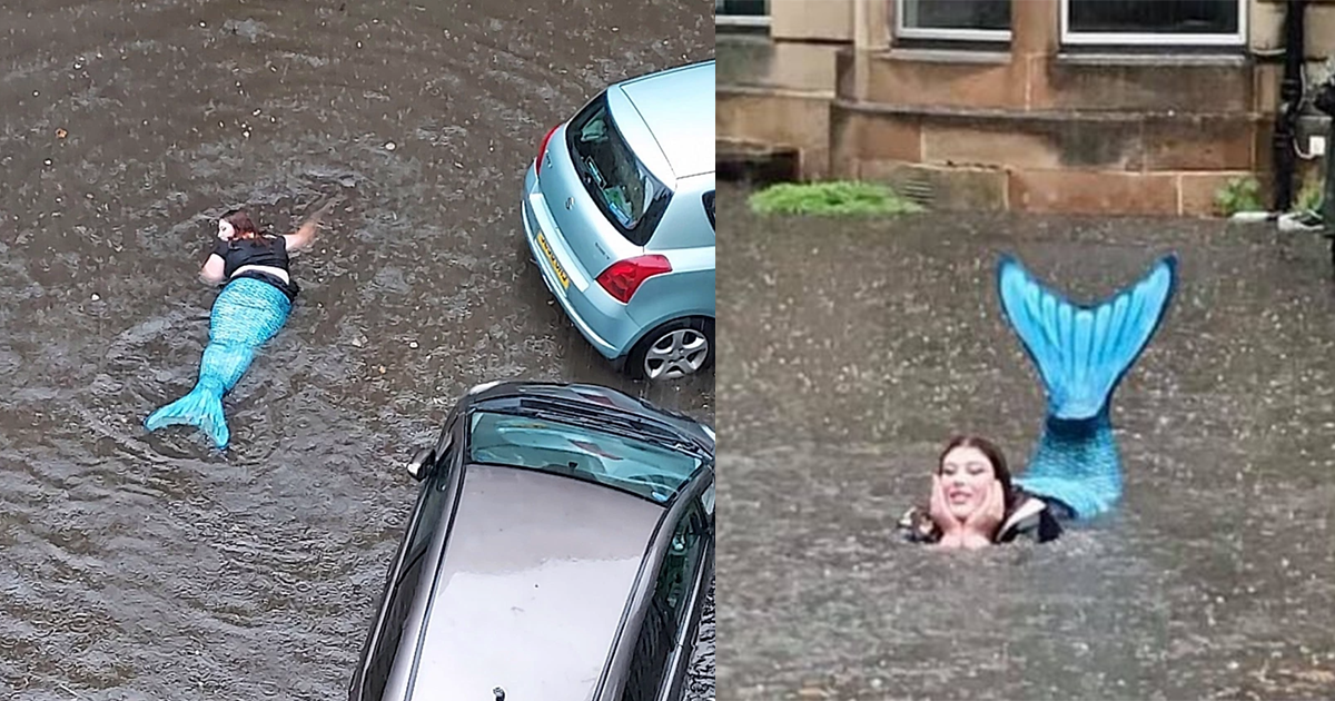 Woman Dressed As A Mermaid Swims In Floodwater