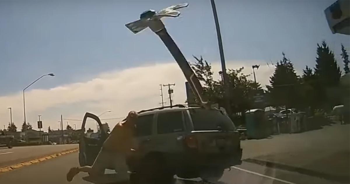 Enraged Man Throws Pickaxe At Windshield